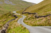 View of winding road surrounded by grass, Landscape in the Yorkshire-Dales region in North-England, Great Britain, Europe