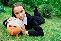 Girl with Piggy