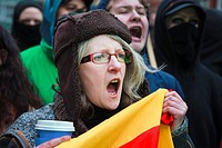 Woman shouting at a street protest and demonstration, Glasgow, Scotland