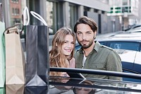 Germany, Cologne, Young couple smiling, portrait