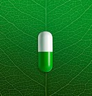 Medicin capsule on leave veins background
