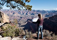Woman checking a map at the Grand Canyon