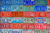 A wall filled with license plates