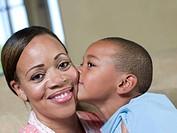 Boy kissing mothers cheek
