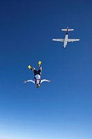 Skydiver with flippers and diving goggles in the air