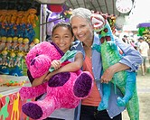 Grandmother and granddaughter enjoying amusement park
