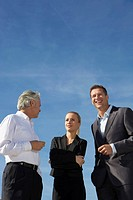 Germany, Bavaria, Munich, Business people standing against sky, smiling