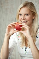 Blond woman with an apple