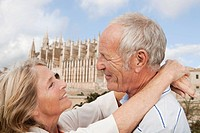 Spain, Mallorca, Palma, Senior couple smiling with Cathedral Santa Maria, portrait