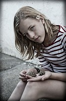 Teenage girl with hand pet turtle.