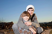 Germany, Bavaria, Father embracing son, smiling, portrait