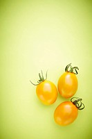 The yellow cherry tomatoes with the green background