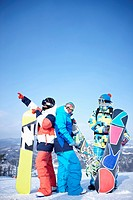 The people wearing the snowboarding wear with the snowboard