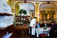 PARIS, France, - Adults Sharing Meals French Bistro Restaurant  Business Lunch at Chez Georges, 1, Rue deu Mail, 75002  Waiter Serving Tables
