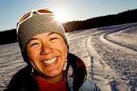 a Japanese_American woman has her portrait taken after running down a snowy road in Custer State, South Dakota.