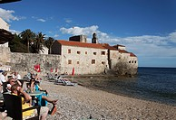 People sitting in a cafe on the city beach, Budva, Montenegro, Europe