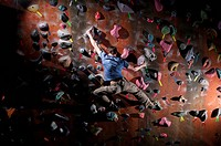 Man climbing indoor rock wall