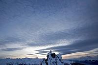 Snowboarder standing on a mountain in twilight, Chandolin, Anniviers, Valais, Switzerland
