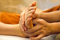 Person receiving foot massage