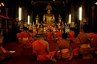 Monks at evening prayer, Wat Mai Suwannaphumaham, Luang Prabang, Laos