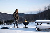 Man and grill in winter outside