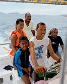 Family on a boat of Liberty Charter snorkeling tour, to Felicité island with octopus hunter Alvis Jean and captain Jonathan Waye_Hive, La Digue and In...