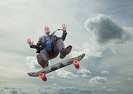 Mixed race businessman on skateboard in sky