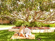 Caucasian couple kissing and having picnic