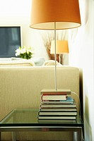 Lamp on stack of books