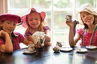 Caucasian girls having tea party