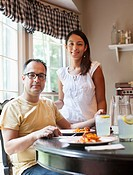 Hispanic couple eating dinner together