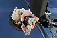 Banknotes stuffed into the Fuel Tank of a Car