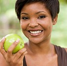 Black woman eating apple