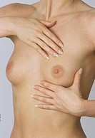 Woman palpating her breast, cancer screening, prevention