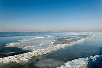 Frozen North Sea with the Hallig Langeness, holm, on the horizon, North Frisia, Schleswig-Holstein, Northern Germany, Germany, Europe