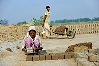 Child labour, 12-year-old girl and her 14-year-old brother working in a brickyard, members of the Christian minority, which is particularly affected b...