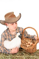 Farm boy with basket of eggs