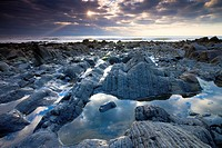 Rock pools and eroded rocks ledges at Sandymouth Bay in North Cornwall, England, United Kingdom, Europe