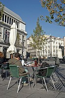 Man sitting in a terrace in Opera square. Madrid, Spain