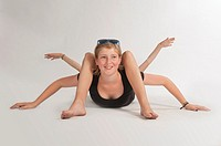Blonde girl lying on the floor simulating bodily contortions.