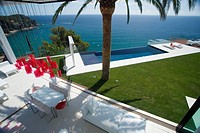 MODERN POOL AND TERRACE IN MEDITERRANEAN GARDEN OVERLOOKING THE SEA
