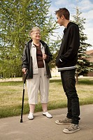 a senior woman talks with a teenage boy, edmonton, alberta, canada