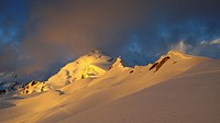 View of snow covered mountain range at sunset, Ishinca, Cordillera Blanca, Ancash Region, Andes, Peru