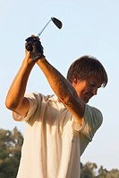 man in mid_swing with a golf club, toremolinos malaga province spain