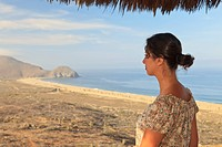 a woman on a hilltop looking out over the ocean, todos santos baja california sur mexico