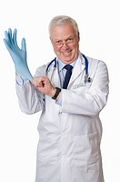 Doctor putting on blue latex glove