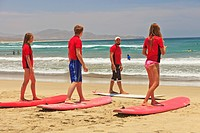 instructors and students with surf lessons at cerritos beach, todos santos baja california sur mexico