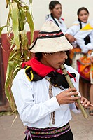 Peru, Cuzco Province, Huaro, young playing flute in traditional dress for the corn feast, Sara Raymi