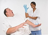 Anxious overweight man looking at nurse