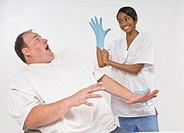 Anxious overweight man looking at nurse